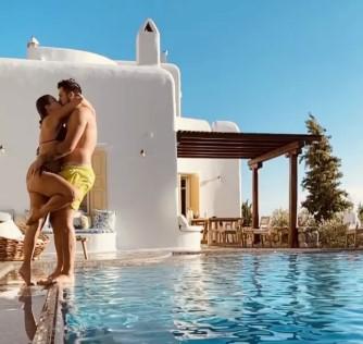 花式秀恩爱!东契奇和女友亲吻好运彩票相拥,随后坠入泳池