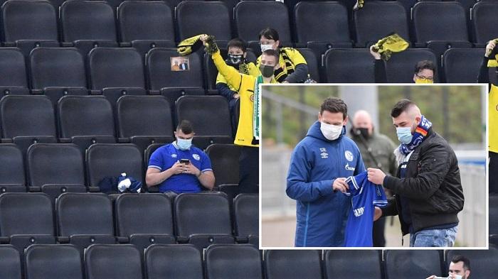 沙尔克球迷孤身一人坐在多特球迷中,得到俱乐部奖励
